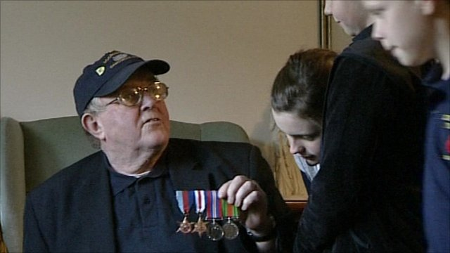 Veteran showing war medals