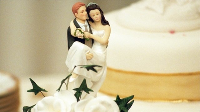 Marzipan married couple on top of a wedding cake
