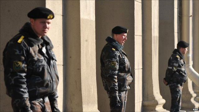 Police officers stand guard outside a metro station hit by a blast in Minsk