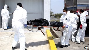 A body found in a mass grave is taken into the local morgue in Matamoros, northern Mexico, 8 April 2011
