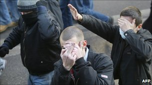 Ultranationalists obscure their faces as they march in Moscow in 2005