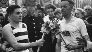 HJ Bignall (right) hands over the Olympic flame to Fred Prevett at Redhill, Surrey in 1948