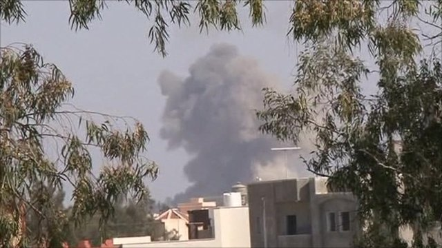 Smoke rises on the Tripoli skyline