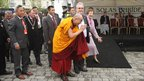 The Dalai Lama, walks with Richard Moore (right) through the centre of Kildare Town