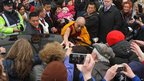 The Dalai Lama is greeted by members of the public outside St Brigid's Church, during his visit to Kildare Town
