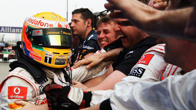 Lewis Hamilton is mobbed after winning in China