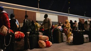 Foreign workers and Libyans queue to try to leave war-torn Misrata