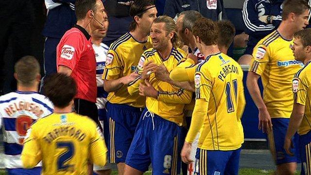 Robbie Savage is held back by Derby team-mates