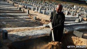 A gravedigger at work in Misrata, Libya, 19 April 2011