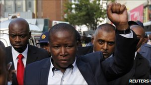 ANC Youth League president Julius Malema (C) gestures outside a Johannesburg court (12 April)