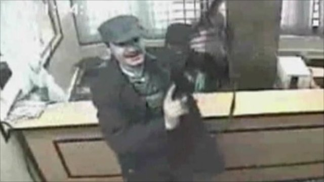 CCTV image of the killer holding a gun in the bank