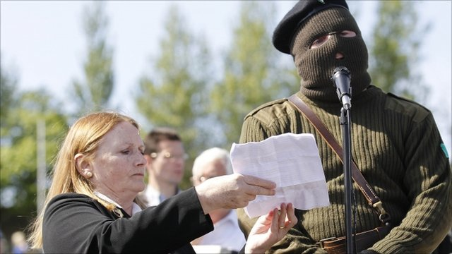 A masked member of the Real Irish Republican Army (RIRA) splinter group reads a statement