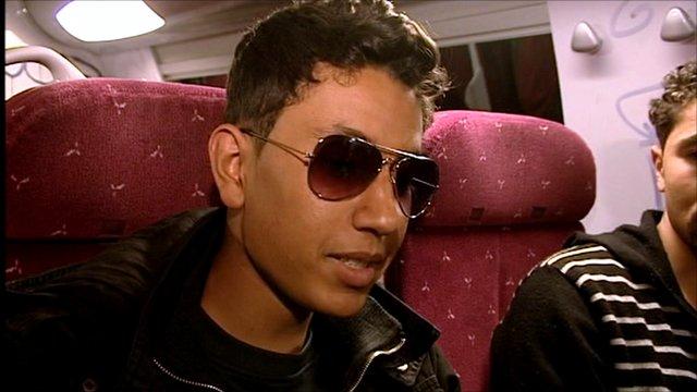 Tunisian man on train to France