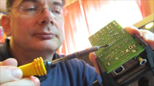 John Honniball solders an 8-bit microprocessor circuit board