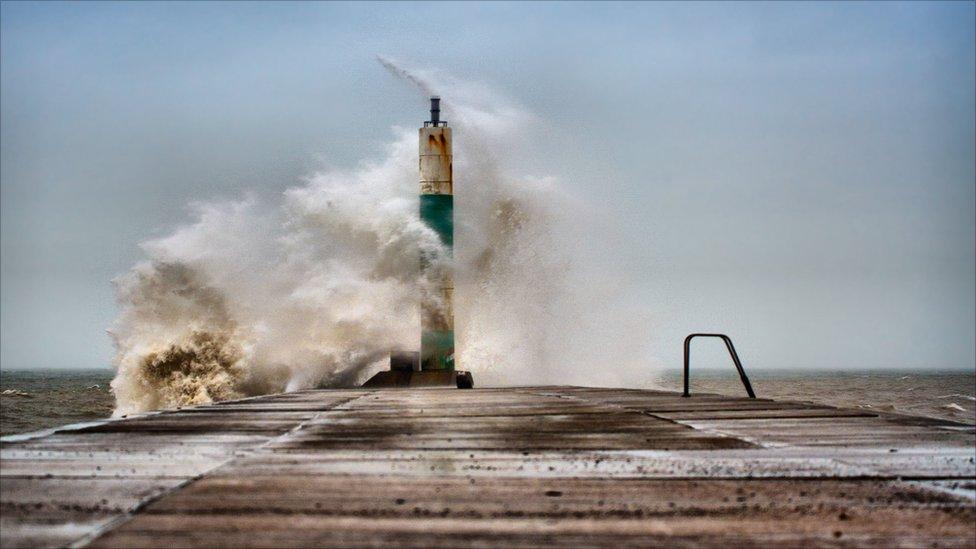 Big waves hitting a pier at Aberystwyth