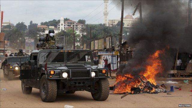 Military police patrol Kampala street