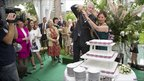 Britain's ambassador to Spain, Giles Paxman, and his wife, Segolene, cut a cake to mark the royal wedding