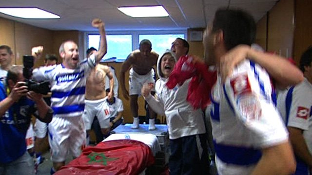 QPR players celebrate winning promotion from the Championship to the Premier League