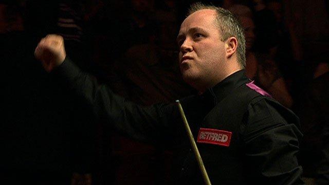 John Higgins celebrates his World Snooker semi-final win over Mark Williams