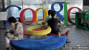 Employees sit in the lobby of Google's Seoul office