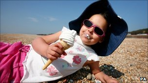 Girl eating icecream during warm April weather
