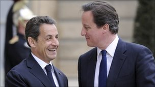 French President Nicolas Sarkozy welcomes British Prime Minister David Cameron prior to a working dinner focused on Libya's conflict on April 13, 2011 at the Elysee presidential palace, in Paris