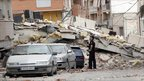 A policeman inspects earthquake damage in Lorca, Spain - 12 May 2011