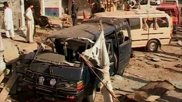 Debris scattered over minibuses caught in explosion