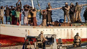 Anti-piracy force boards a hijacked dhow (photo courtesy EU NAVFOR