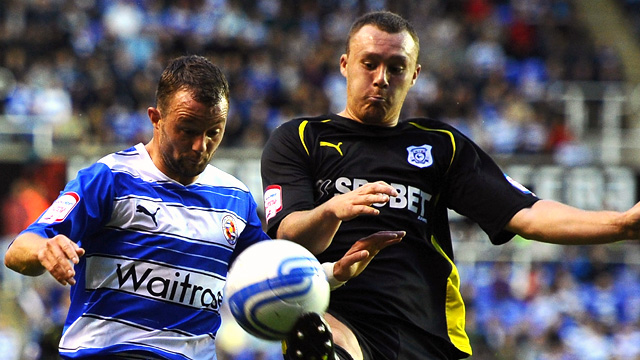 Noel Hunt of Reading is challenged by Darcy Blake of Cardiff City