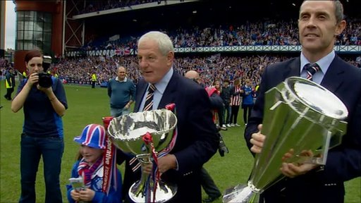 Rangers manager Walter Smith and captain David Weir (right) carry the season's trophies