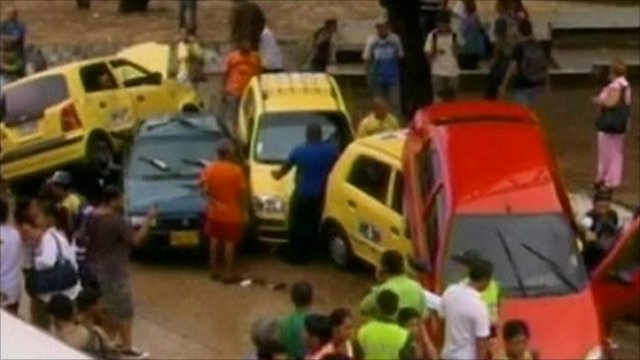 Cars piled up in Colombia floods