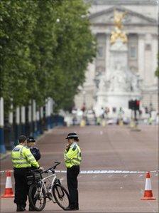 Police man a cordon on the Mall outside Buckingham Palace