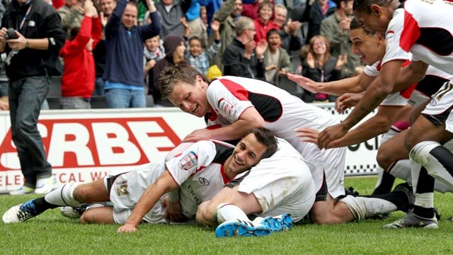 MK Dons celebrate Sam Baldock's goal
