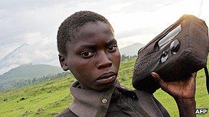 Refugee listens to the radio