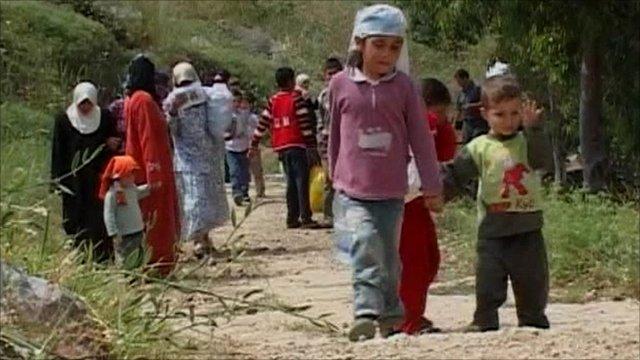 Syrian refugees crossing border into Lebanon