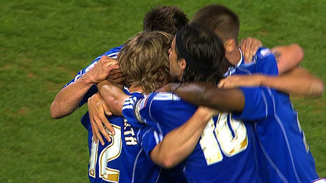 Peterborough players celebrate reaching the League One play-off final