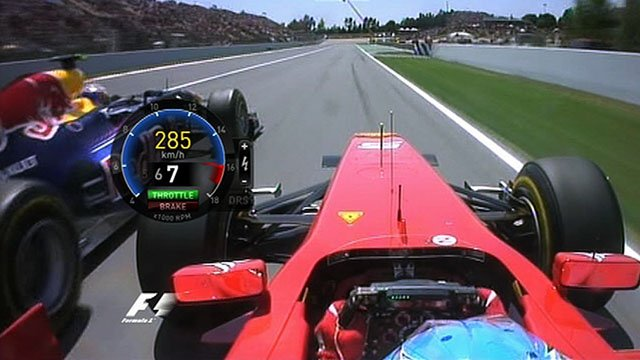 Fernando Alonso powers past the Red Bulls at the start of the Spanish GP