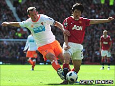 Blackpool's Charlie Adam and Park Ji-sung of Manchester United