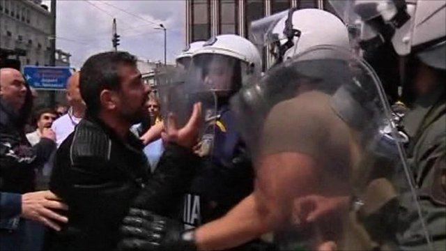 Protester and police in Greece