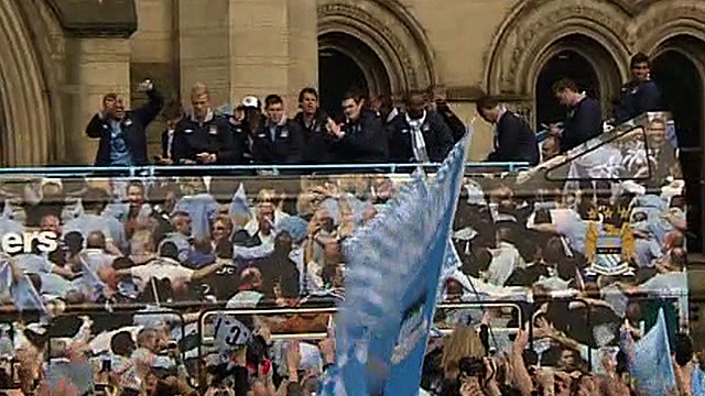 Manchester City players on their team bus during the club's victory parade