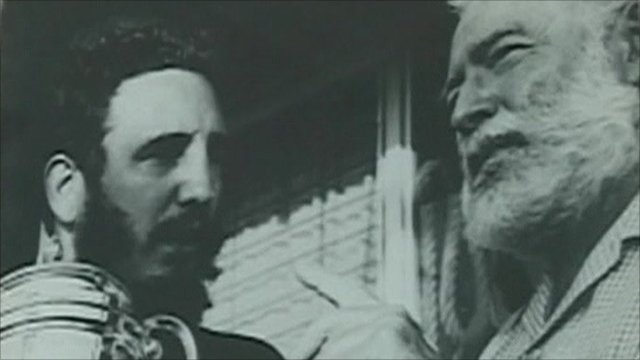 Picture of Ernest Hemingway presenting fishing trophy to Che Guevara
