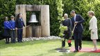 Barack Obama stands with Ireland's President Mary McAleese at the Peace Bell during a tree planting ceremony in Dublin
