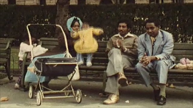 A family relaxes in Piccadilly Gardens in Manchester in the 1970s