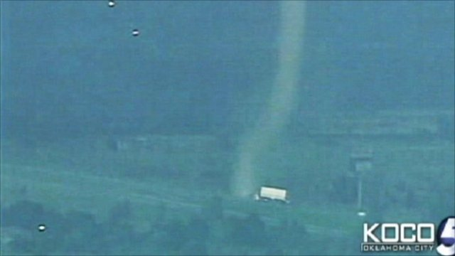 Twister approaching a parked truck