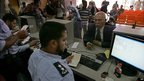 Palestinian border police check identity documents of travellers crossing into Egypt