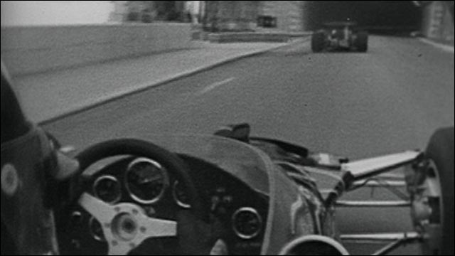 Five-time Monaco race winner Graham Hill commentates on a lap around the famous Monte Carlo circuit