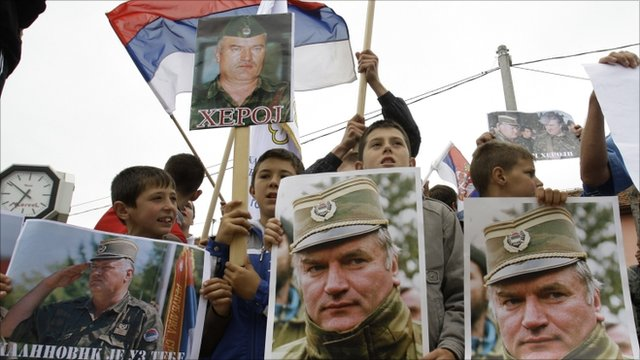 People holding Serbian flags and photos of former General Ratko Mladic during a protest in Kalinovik, Bosnia