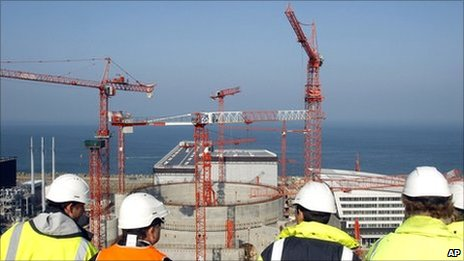 People look at the construction site of the third-generation European Pressurised Water nuclear reactor (EPR) in Flamanville, north-western France, in this file picture taken in April 2011