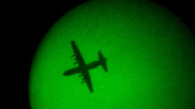 Plane in the air carrying supplies
